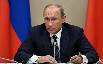 Russian President Vladimir Putin holds a meeting with senior government officials at the Novo-Ogaryovo residence outside Moscow, Russia on Wednesday, Sept. 30, 2015. Russian military jets carried out airstrikes against the Islamic State group in Syria on Wednesday for the first time, after President Vladimir Putin received parliamentary approval to send Russian troops to Syria. (Photo by Alexei Nikolsky/RIA Novosti, Kremlin Pool Photo via AP)