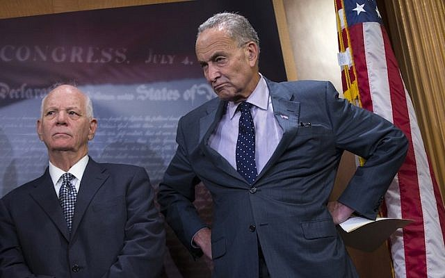 Sen. Charles Schumer, D-N.Y., right, accompanied by Sen. Ben Cardin, D-Md., listening during a news conference about legislation on Iran policy and Middle East security, Thursday, Oct. 1, 2015, on Capitol Hill in Washington (Evan Vucci/AP Images/JTA)