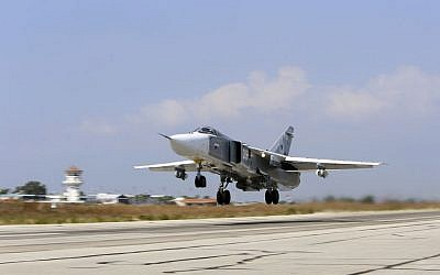 In this photo taken on Saturday, Oct. 3, 2015, Russian SU-24M jet fighter armed with laser guided bombs takes off from a runaway at Hmeimim airbase in Syria. (AP Photo/Alexander Kots, Komsomolskaya Pravda, Photo via AP)