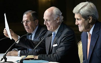 Russian Foreign Minister Sergei Lavrov, left, and Secretary of State John Kerry, right, listen as UN Special Envoy for Syria Staffan de Mistura speaks during a news conference in Vienna, Austria, Friday, October 30, 2015 (Brendan Smialowski/Pool via AP)