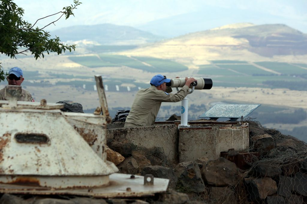 A United Nations observer atop Mount Bental on the Israeli side of the border with Syria, May 30, 2015. (Yossi Zamir/Flash90/via JTA)