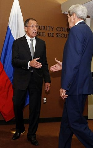 Russian Foreign Minister Sergey Lavrov, left, greets US Secretary of State John Kerry as he arrives for a meeting at UN headquarters, September 30, 2015. (AP/Jason DeCrow)