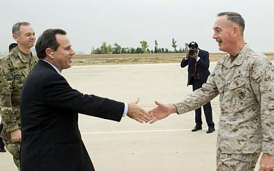 US Ambassador to Iraq, Stuart E. Jones and U.S. Army Lt. Gen. Sean McFarland, left, greet Joint Chiefs Chairman Gen. Joseph Dunford Jr. upon his arrival at Irbil, Iraq, Tuesday, Oct. 19, 2015. (D. Myles Cullen/Pentagon via AP)
