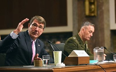 Defense Secretary Ash Carter, accompanied by Joint Chiefs Chairman Gen. Joseph Dunford, testifies on Capitol Hill in Washington, Tuesday, Oct. 27, 2015, before the Senate Armed Services Committee. (AP Photo/Kevin Wolf)