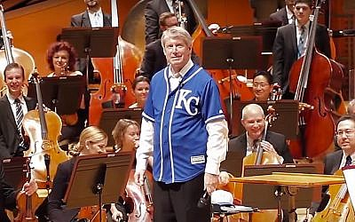 Kansas City Symphony music director Michael Stern wears a Royals jersey over his concert tuxedo (YouTube screenshot)