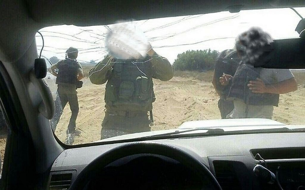 IDF soldiers at the scene of a shooting attack against an Israeli vehicle near the border with the Gaza Strip on Sunday, October 11, 2015 (courtesy)