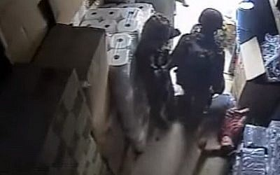 Israeli soldiers are seen beating a Palestinian man in a video released by B'Tselem (YouTube screen capture)