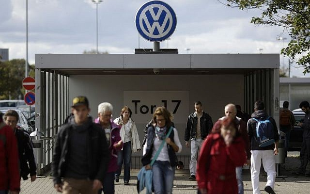 People leave the Volkswagen factory at Gate 17 in Wolfsburg, Germany. (AP Photo/Markus Schreiber)