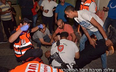 Medics working on a soldier who was stabbed in Afula on October 8, 2015. (Police spokesperson)