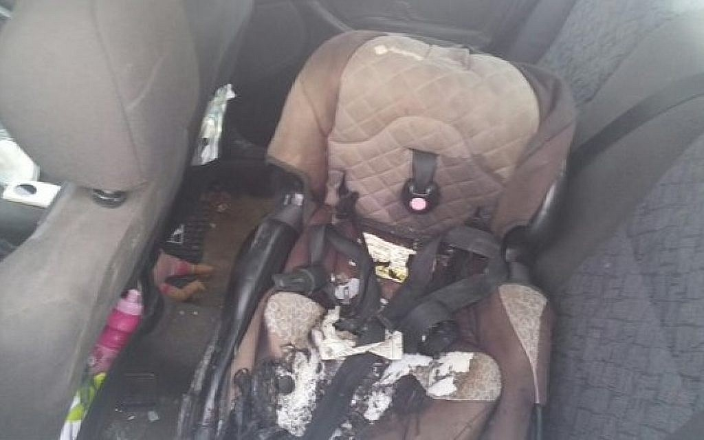 The charred baby seat of a 4-year-old girl who was moderately wounded when the car she was traveling in was hit with a Molotov cocktail hurled by Palestinian terrorists. (IDF)
