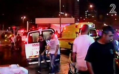 Paramedics responding to a terror attack at the Beersheba Central Bus Station on October 18, 2015. (screen capture: Channel 2)