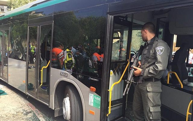 Police guarding a bus after terrorists opened fire and stabbed passengers in Jerusalem on October 13, 2015. (Courtesy Police)
