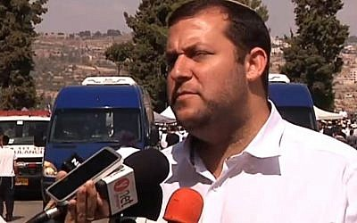 Samaria Regional Council head Yossi Dagan speaks to the media after the funeral of Eitam and Naama Henkin on Friday, October 2, 2015. (Screen capture Channel 2)