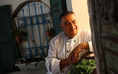 Chef Moshe Basson outside his Eucalyptus Restaurant in Jerusalem (Liron Almog/Flash 90)