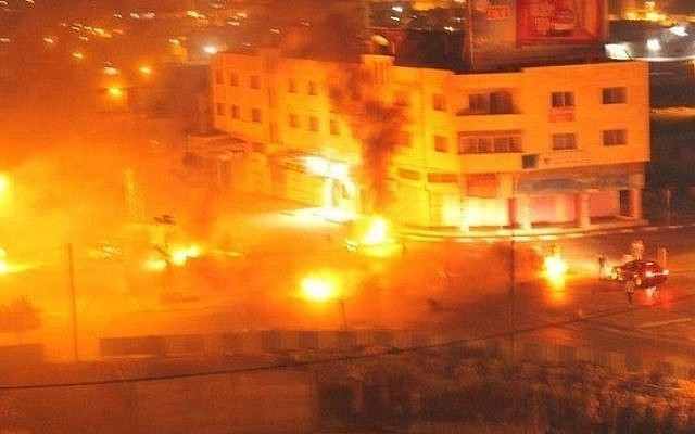 File: Screenshot from the fire started by Palestinian rioters at Joseph's Tomb in Nablus, in the West Bank, on October 16, 2015.