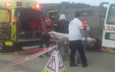 Rescue personnel at the scene of a stabbing attack on an IDF soldier near the checkpoint in the area of Gvaot in the West Bank, on October 23, 2015. (screen capture: Twitter)