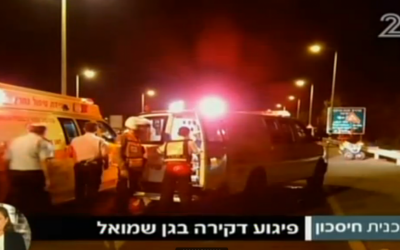 Emergency responders at scene of stabbing on Route 65 near Hadera on October 11, 2015 (screen capture: Channel 2)