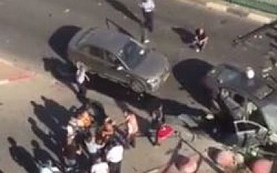 The scene of a mob-hit car bombing in Hadera in which one man was seriously injured, October 21, 2015. (Screen capture: YouTube)