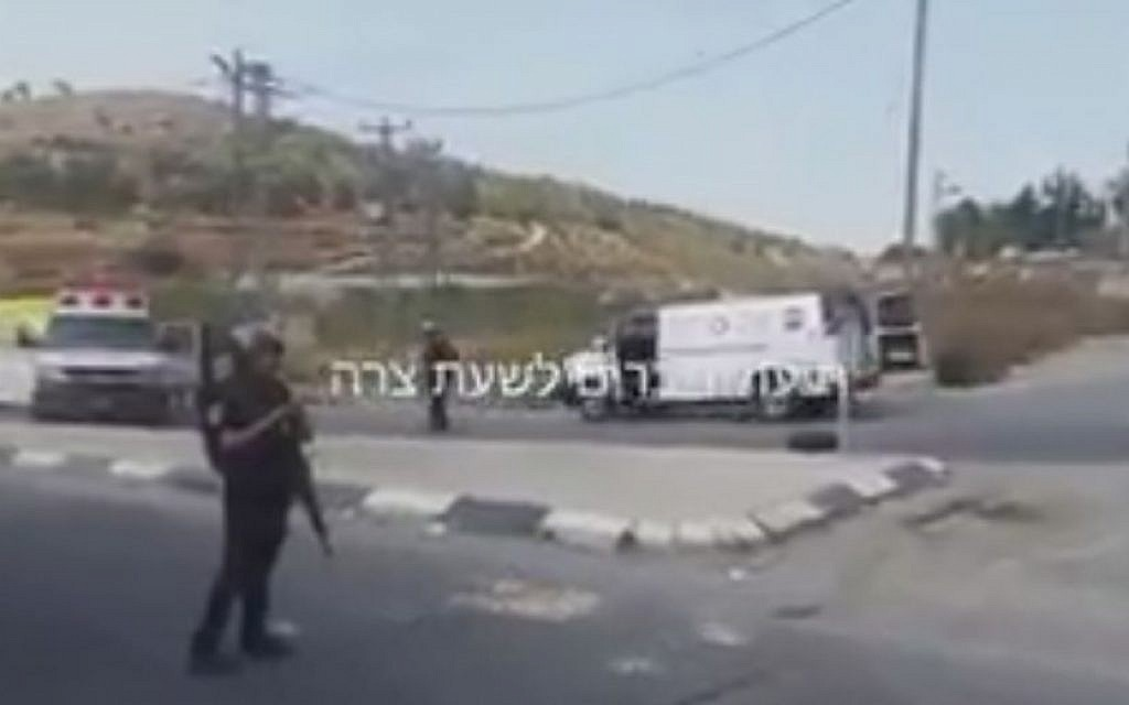 Soldiers and paramedics at the scene of an apparent stoning and hit-and-run attack in the West Bank on October 20, 2015. (Screen capture: Friends in Time of Need/Twitter)