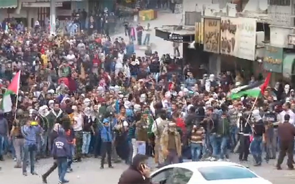 Palestinians protest in the West Bank city of Hebron on October 27, 2015 (screen capture: YouTube)