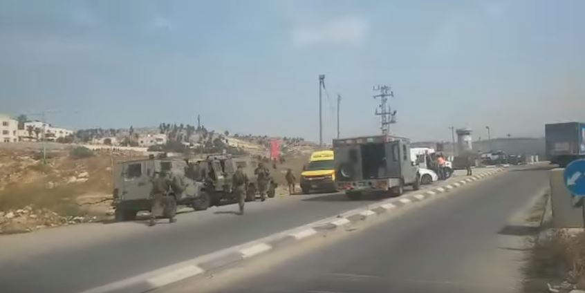 The scene where an Israeli man was killed after being run over by a truck driven by a Palestinian, near the West Bank city of Hebron, October 20, 2015. It was not initially clear if the collision was deliberate or not. (Arutz Sheva TV)