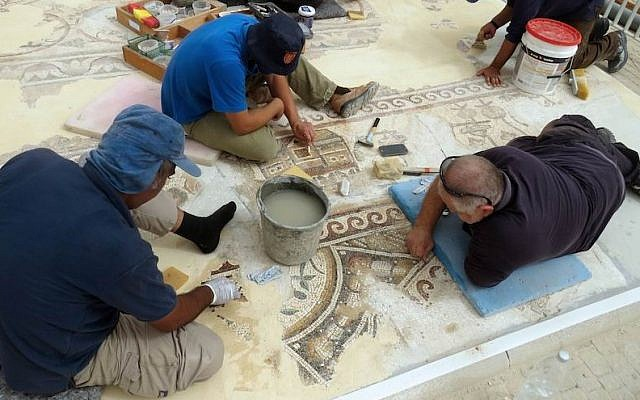 Israel Antiquities Authority workers restoring the Kiryat Gat mosaic. (Nikki Davidov/Israel Antiquities Authority via JTA)