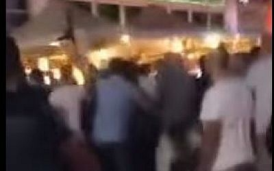 Screen capture from mobile phone footage reportedly showing a Jewish mob attacking an Arab man in Netanya. (YouTube/Netanyanet)