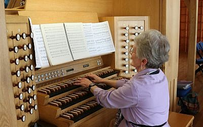 Marybeth Jones at the organ at Brigham Young University's Jerusalem Center (Shmuel Bar-Am)