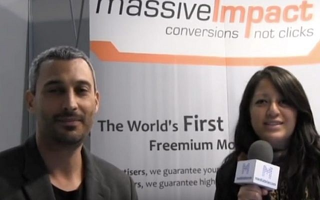 MassiveImpact CEO Sephi Shapira (L) in an interview at Mobile World Congress, February 25, 2013 (Courtesy)