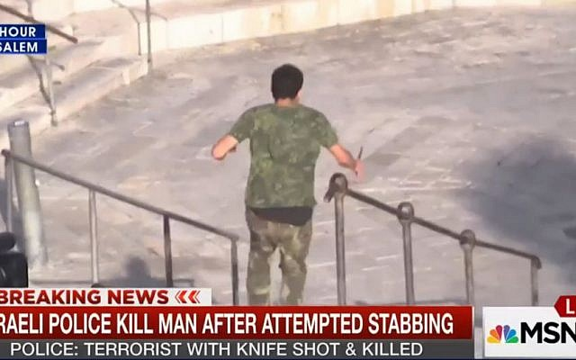 A man rushing at police with a knife in Jerusalem on October 14, 2015, caught by an MSNBC news crew. (Screen capture: MSNBC)