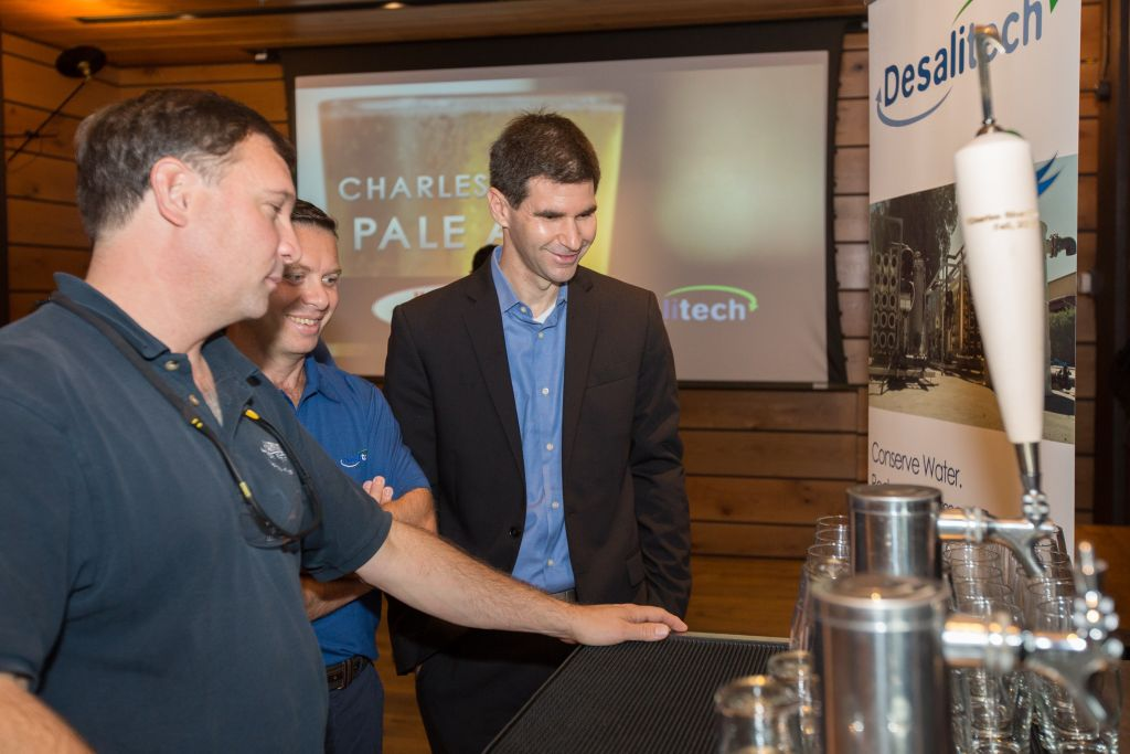 Desalitech CEO Nadav Efraty (right) at the September 30, 2015 launch of Harpoon Brewery's new Charles River Pale Ale, brewed from Charles River water treated by the Israeli-founded Desalitech. (Elan Kawesch/The Times of Israel)