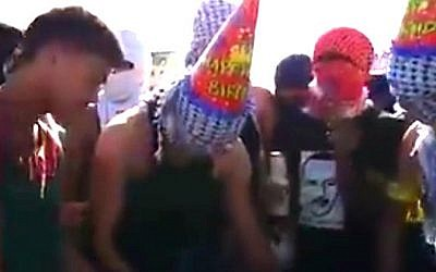 Palestinian demonstrators celebrating a birthday amid protests (screencap/DAM Palestine)