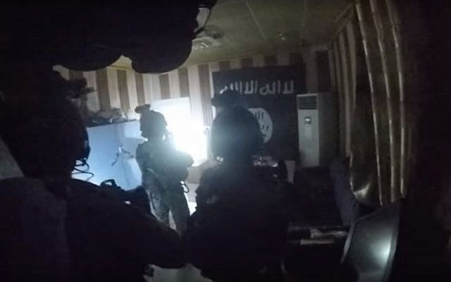 An image from a video purportedly showing a joint US-Kurdish raid on an Islamic State prison in the town of Hawija, Iraq on October 22, 2015. (screen shot: YouTube)