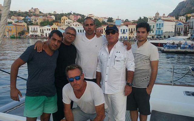 Members of Ashdod's Poseidon Sailing Club who rescued 11 Syrian and Iraqi refugees off of the Greek coast on October 18, 2015. (Gal Baruch, courtesy)