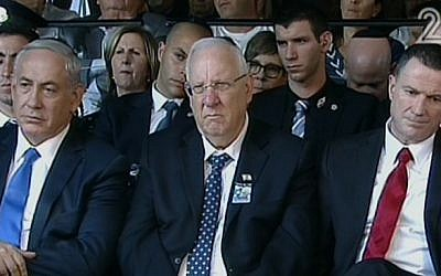 PM Benjamin Netanyahu (left), President Reuven Rivlin (center) and Knesset Speaker Yuli Edelstein attend the memorial service to mark 20 years since the assassination of Yitzhak Rabin (screen capture: Channel2)
