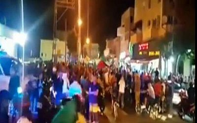 Arab residents of  Jaffa protest amid ongoing Israeli-Palestinian violence, on Tuesday, October 6, 2015 (screen capture: Channel 2)