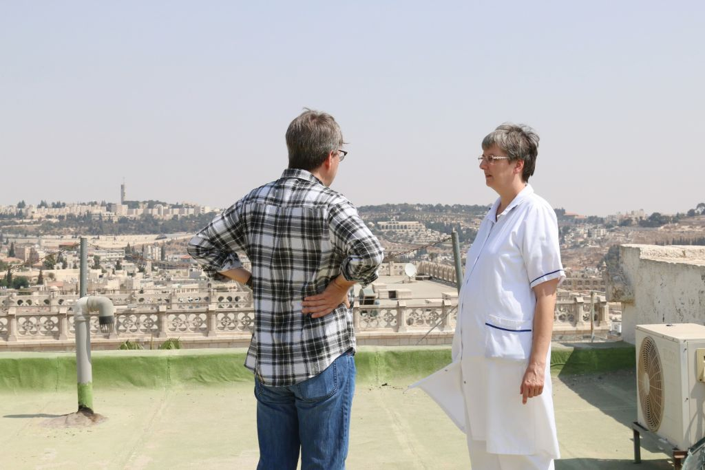 Sister Monika and a visitor on the rooftop of Le Hȏpital Saint-Louis (Shmuel Bar-Am)