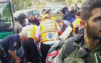 Police and medics at the scene of a stabbing attack in Jerusalem on Thursday, October 8, 2015 (screen capture: Channel 2)
