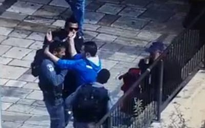A screen capture from security footage showing a man trying to stab a police officer outside Jerusalem's Old City on October 12, 2015.