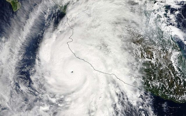 This satellite image taken at 1:30 p.m. EDT on Friday, October 23, 2015, and released by NASA, shows the eastern quadrant and pinhole eye of Hurricane Patricia moving towards southwestern Mexico. (Goddard MODIS Rapid Response Team/NASA via AP)