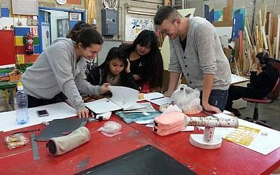 Tovanot kids at work at Herzog High School, Holon (Courtesy)