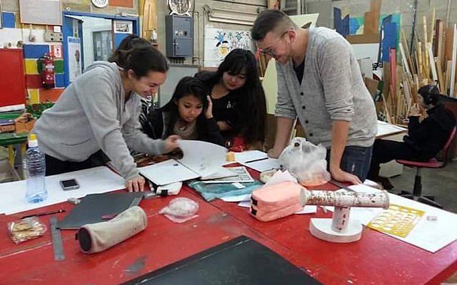 Tovanot kids at work at Herzog High School, Holon (Courtesy)