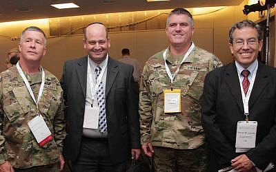 (L to R) Major General James A. Hayer, US Army;  Zohar Yinon, CEO of Hagihon; Kevin Harry, US Army; Steve Levitz, DEP Director (Dima Kreminski)
