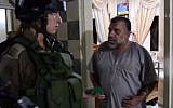 Sheikh Hassan Yousef is arrested in his home by IDF troops, October 20, 2015. (Screen capture from YouTube)