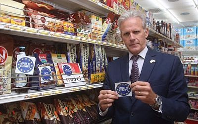 Kulanu MK Michael Oren shows a 'Made in Europe' label he prepared a few weeks earlier, in response to the European decision to label products made in territories Israel captured in the Six Day War in 1967. (Courtesy Michael Oren)