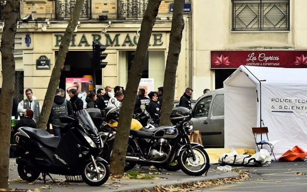 Forensic police are pictured at the Rue de Charonne in Paris on November 14, 2015, following a series of coordinated attacks in and around Paris late Friday which left more than 120 people dead.  (AFP PHOTO/LOIC VENANCE)