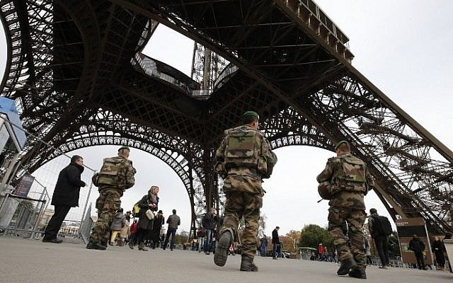 French soldiers patrol the area at the foot of the Eiffel Tower in Paris on November 14, 2015, following a series of coordinated attacks in and around Paris that left more than 120 people dead. (AFP/Francois Guillot)