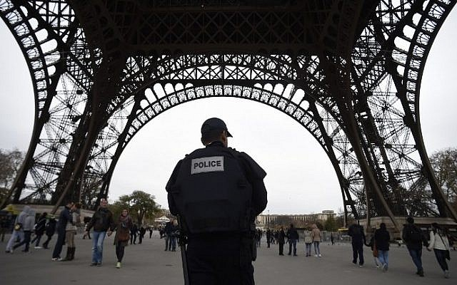 Police patrol in Paris on November 14, 2015 at the Eiffel Tower. (AFP Photo/Lionel Bonaventure)