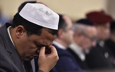 Imam of the Drancy Mosque, Hassene Chalghoumi, attends a ceremony at the Grande Synagogue de la Victoire in Paris on November 15, 2015 for the victims of a series of deadly attacks in the French capital two days earlier. (AFP PHOTO/LOIC VENANCE)