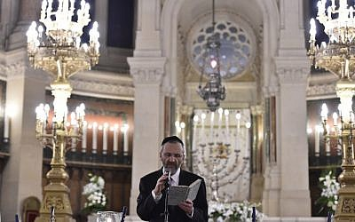 Gilles Bernheim, former chief rabbi of France, speaks at the Grande Synagogue de la Victoire in Paris. The synagogue, and the Consistoire next door, are heavily barricaded against anti-Semitic violence. (AFP/Loic Venance)